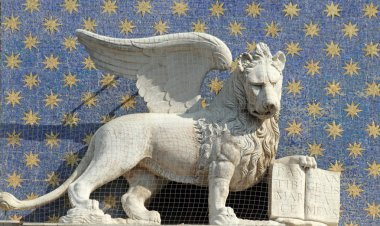 The symbol of Venice winged lion of St. Mark holding a book repr