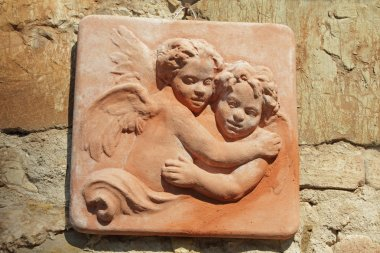 Couple of two hugging angels