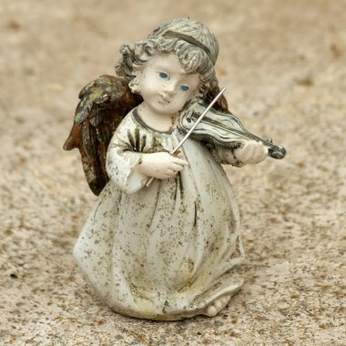 little angel figurine  playing violin