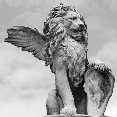 Venetian lion sculpture isolated on sky