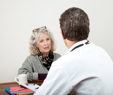 Mature Woman Talking with Her Doctor