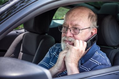 Frightened Senior Man in Car on Cell Phone