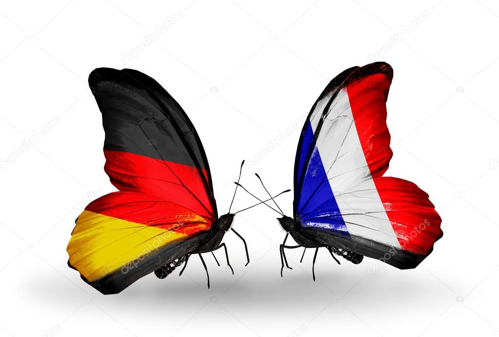 deux papillons avec des drapeaux sur les ailes comme symbole des relations en allemagne et en. Black Bedroom Furniture Sets. Home Design Ideas