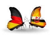 Dva motýli s příznaky na křídlech jako symbol vztahů, Německo a Brunej