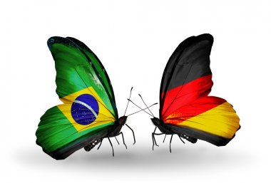 Two butterflies with flags on wings as symbol of relations Brazil and Germany