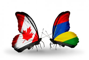 Two butterflies with flags on wings as symbol of relations Canada and Mauritius