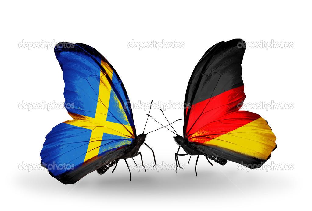 zwei schmetterlinge mit flaggen am fl gel als symbol f r beziehungen schweden und deutschland. Black Bedroom Furniture Sets. Home Design Ideas