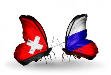 Two butterflies with flags of Switzerland and Russia on wings