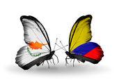 Dva motýli s vlajkami vztahů, Kypru a columbia