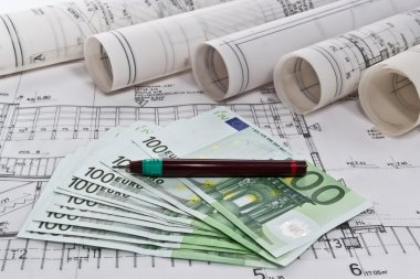 Architectural project blueprints rolls and plans business with euro money