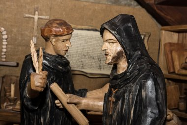 Wooden statues - monks in the monastery