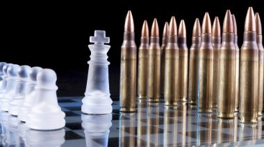 Battle field with bullets on glass chess table on black background with reflection stock vector