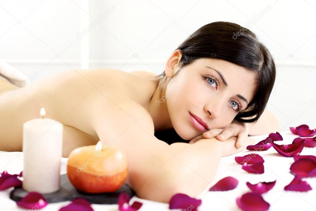 Young beautiful woman in Spa massage salon, relax, happiness