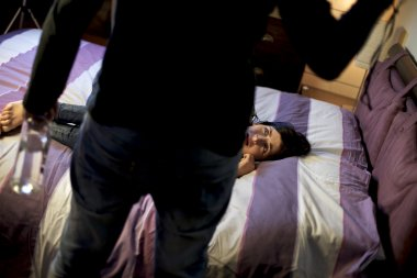 Drunk man abusing wife in bed at home