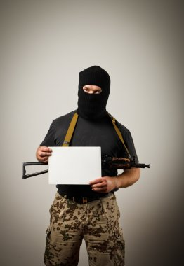 Gunman is holding white paper