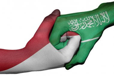 Handshake between Indonesia and Saudi Arabia