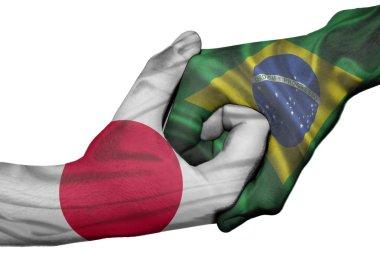 Handshake between Japan and Brazil