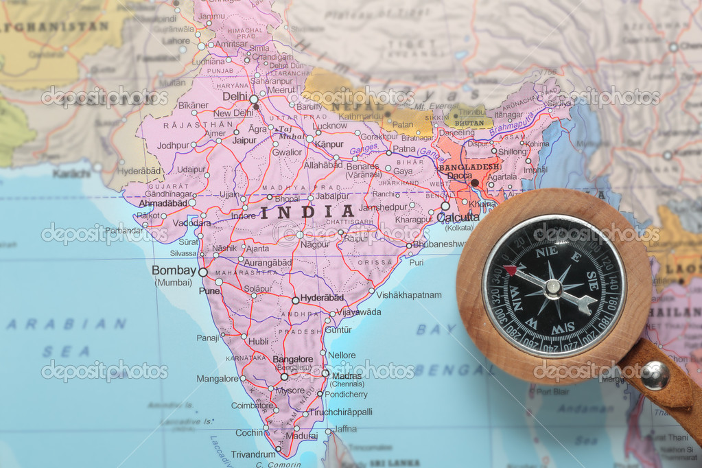 compass on a map pointing at india and planning a travel destination photo by mattiaath