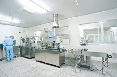 Technicians working in the pharmaceutical production line