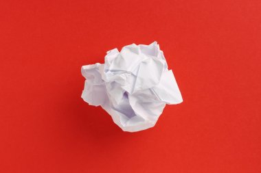 Paper Ball on Red Background