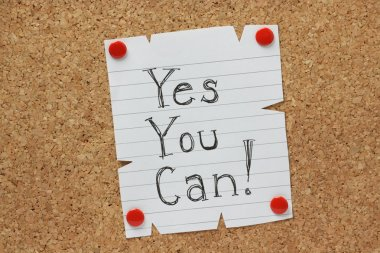 The phrase Yes You Can written by hand on a piece of paper pinned to a cork notice board stock vector
