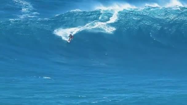 Professional surfer rides a large wave