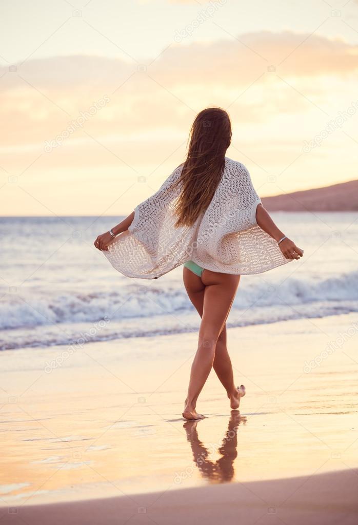 Woman walking on a sandy beach