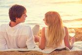 Honeymoon concept, Man and Woman in love, Couple enjoying glass