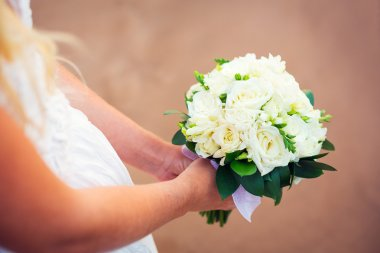 Bride holding bouquet of white flowers