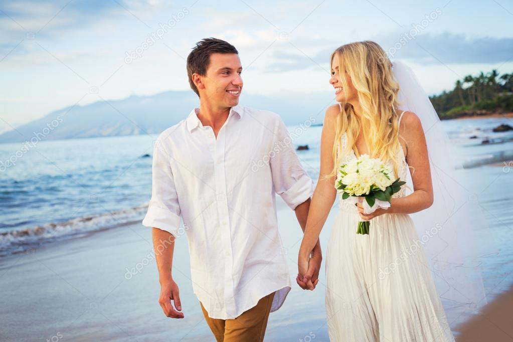 Bride and Groom, Walking on a Beautiful Tropical Beach at Sunset