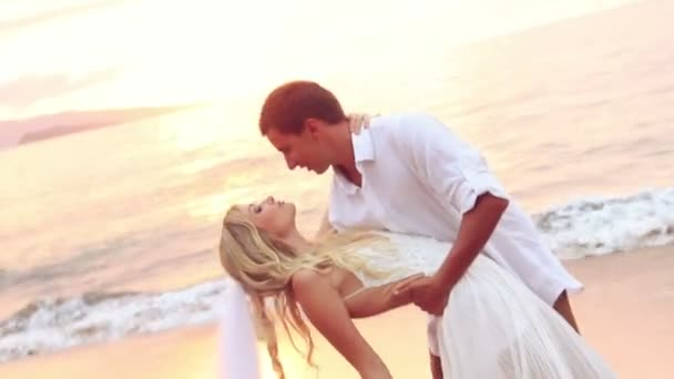 Bride and Groom on Beautiful Tropical Beach at Sunset