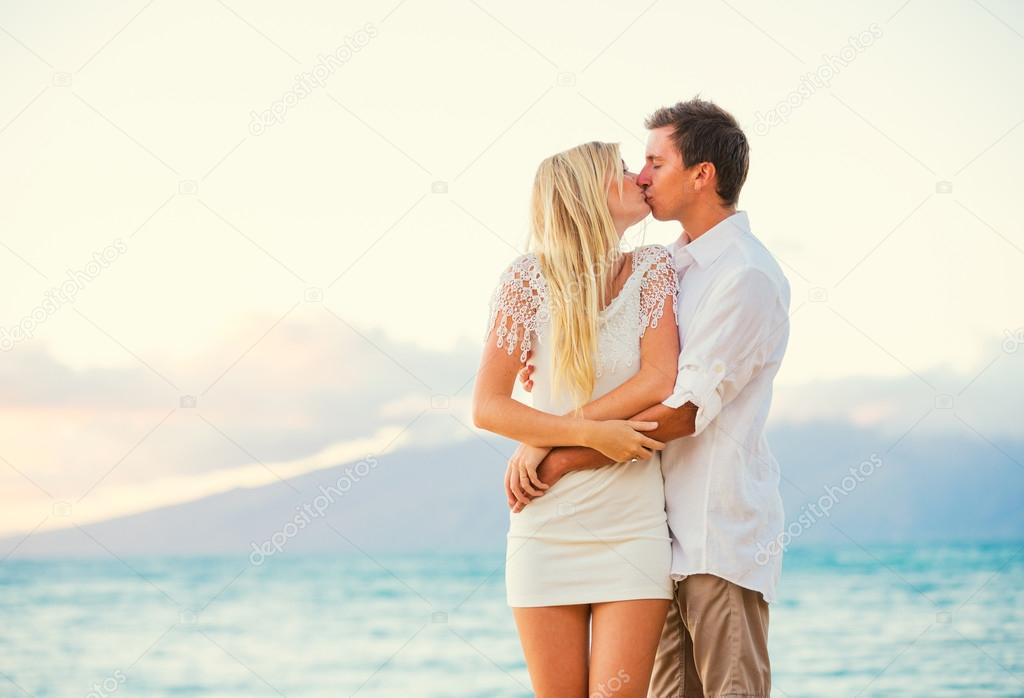 Couple Enjoying Sunset on the Beach