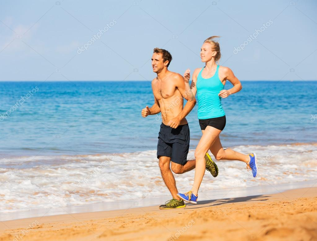 Couple running on the beach