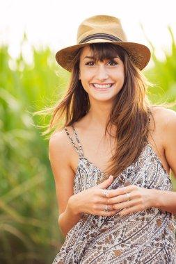 Beautiful Young Woman Outdoors in Sun Dress
