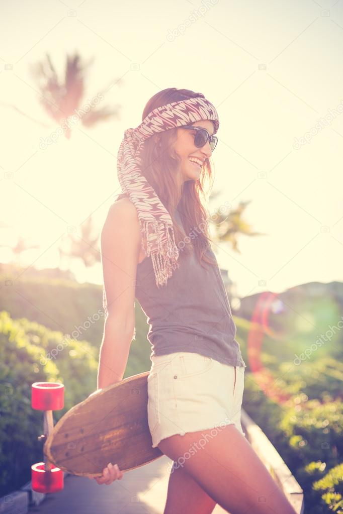 Hipster girl with skate board