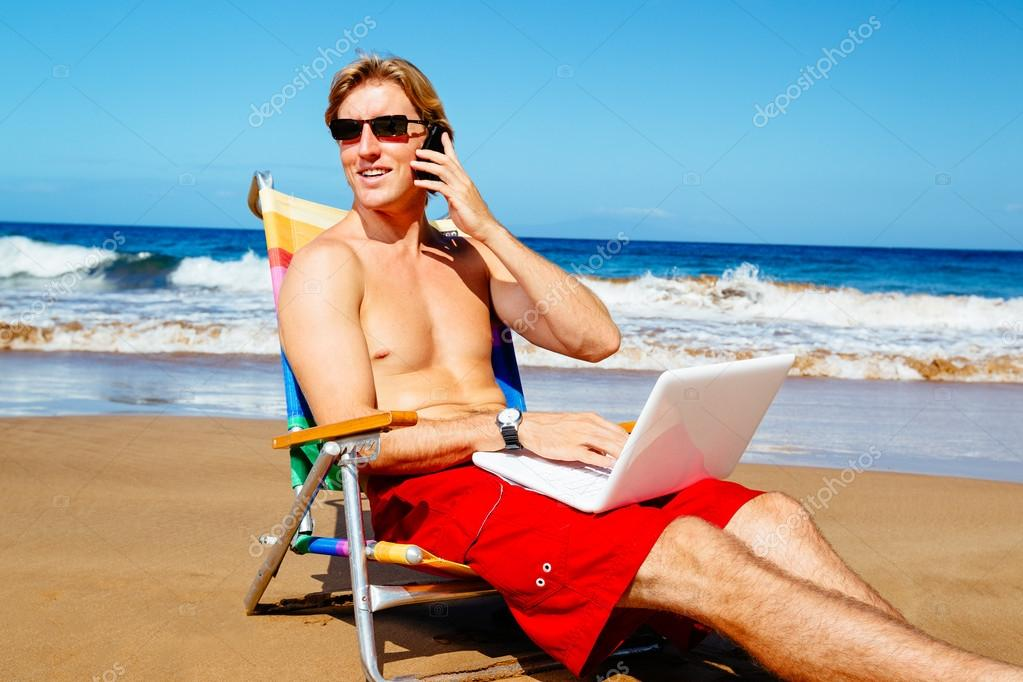 Businessman Relaxing at the Beach with Laptop Computer