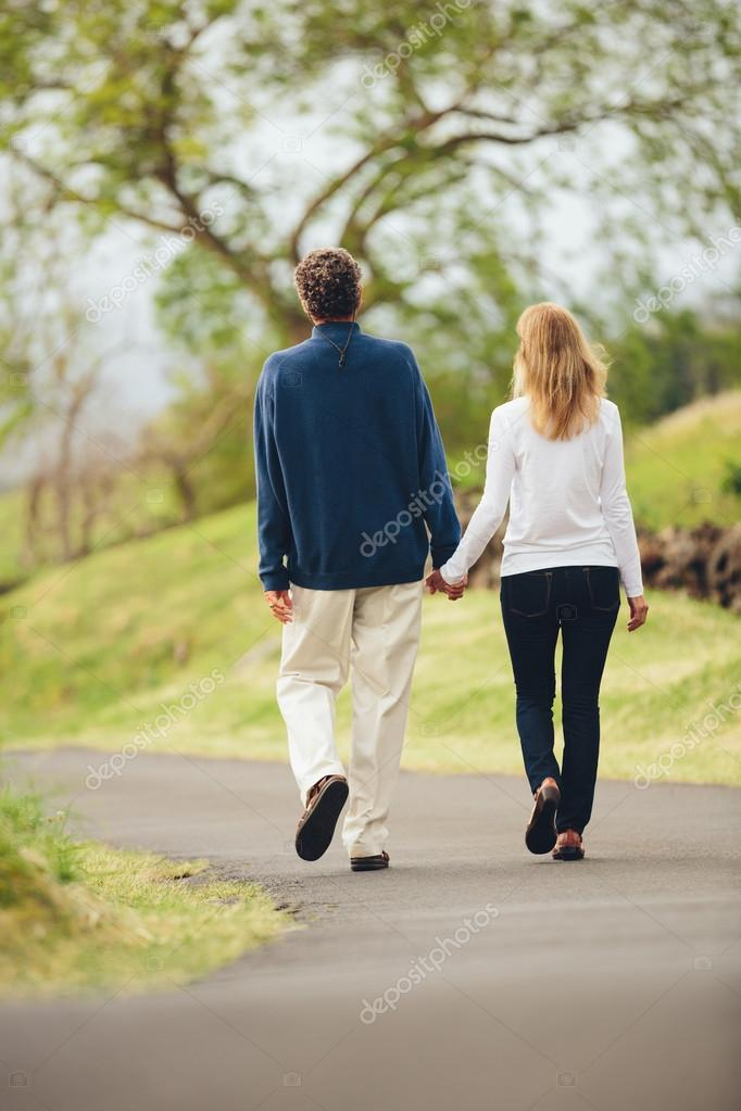 Middle aged couple walking