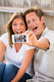 Fotografie Couple taking selfie with phone
