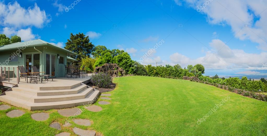 Home with grassy lawn