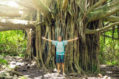 Man standing in front of banyan tree