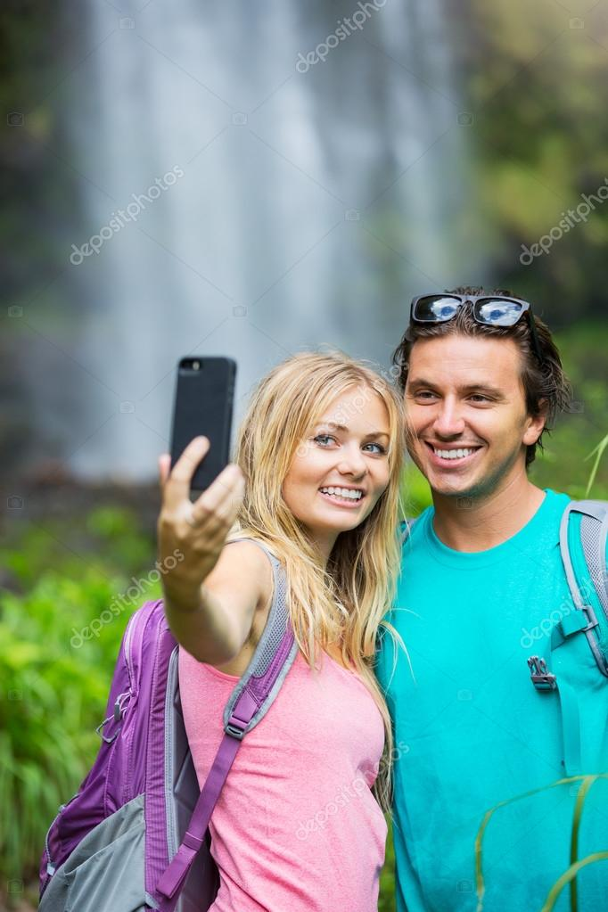 Couple taking pictures together on hike