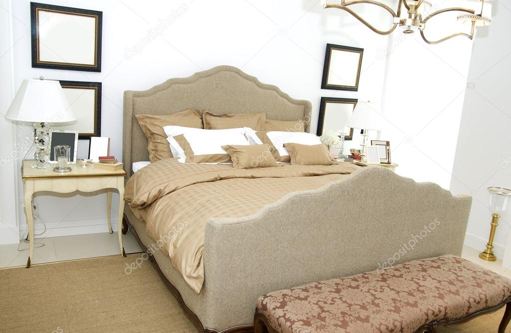 A Large Comfortable Bedroom With A Bed And Lots Of Pillows Stock Photo C Lester120 27873475