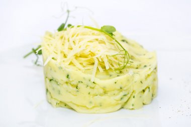 Mashed potatoes with herbs and cheese