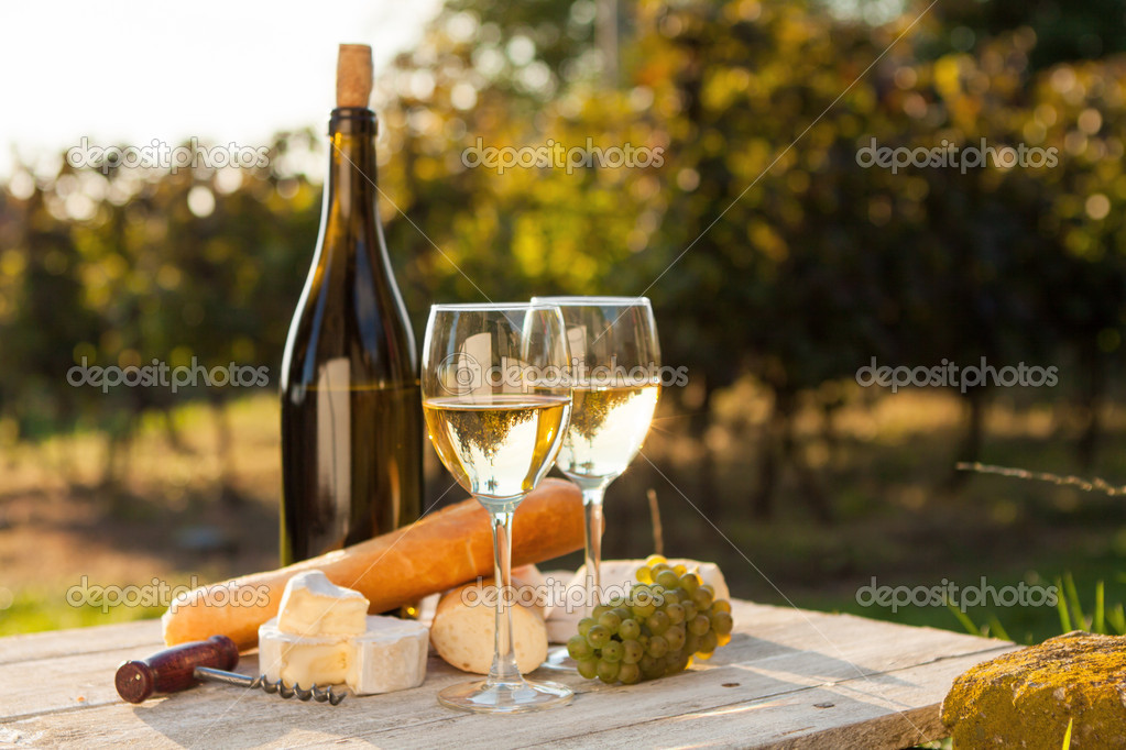 Two glasses of white wine and bottle