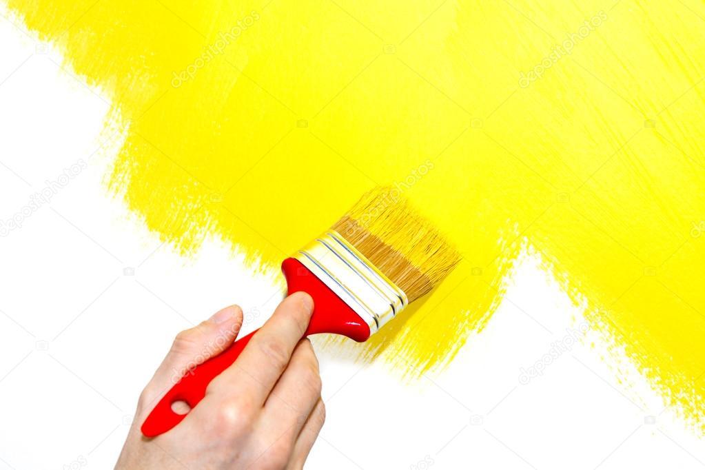 Painting a wall yellow — Stock Photo © rsedlacek #36070663