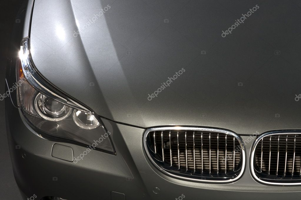 Silver luxury car in a studio environment