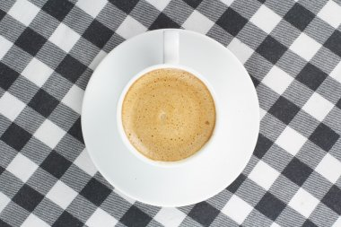 Coffee on a checkered tablecloth top view