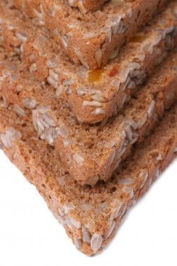 triangles bread with nuts, raisins and sunflower seeds isolated