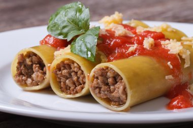 cannelloni pasta with minced meat and tomato sauce