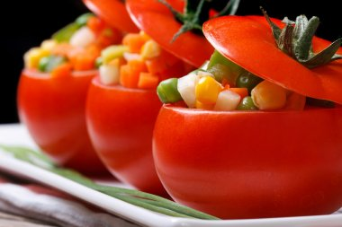 tomatoes stuffed with fresh vegetables horizontal. low key